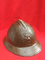 Belgium soldiers M26/31 helmet rare to find in nice condition with paintwork named and numbed complete with badge,leather chinstrap,leather liner found in Dunkirk from the 1940 pocket