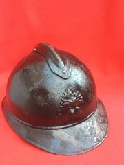 French Infantry soldiers M15 Adrian helmet with original black paintwork,badge found on the Somme battlefield