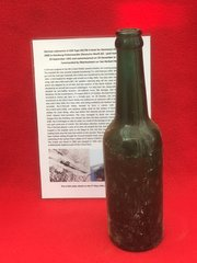 German glass beer bottle it is maker marked with a cross on the bottom,no damage on it recovered from U-Boat U534 which was sunk on the 5th May 1945
