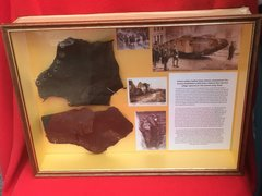Glass framed British soldiers leather boot remains recovered from the Village of Flers the first village captured using Tanks on the Somme battlefield of 1916