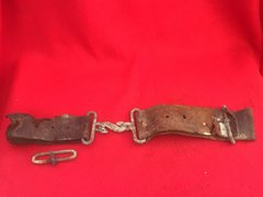 British soldiers snake belt buckle with leather belt from 1914 pattern webbing recovered from Mametz Wood on the Somme battlefield of 1916