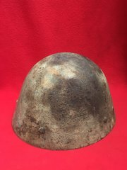 Finnish soldiers M40 helmet with green camouflage paintwork recovered from Finland on the battlefield of Lapland from the battle of 1944-1945