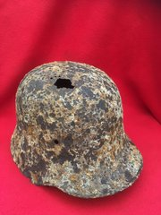 German M16 helmet still with leather liner remains it has mud and dirt attached recovered in 2016 from Flers the first village on The Somme battlefield captured using Tanks