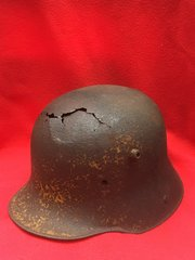 German M16 helmet very nice condition with yellow paint remains and has battle damaged crack at the front recovered from The 1916 Somme battlefield