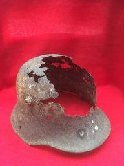 German M16 helmet in relic condition recovered from Mametz Wood on the Somme battlefield