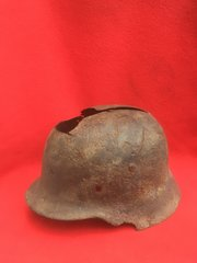 German soldiers M40 helmet with decal,paintwork remains,battle damaged recovered from the area of the Gothic Line near Bologna in Italy 1944-1945 battlefield