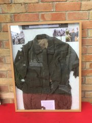 Very Rare framed original German soldiers M40 Jacket recovered from the basement of a house on the outskirts of Bastogne from the battle of the Bulge in the winter of 1944
