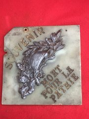 Trench art wall plaque celebrating French victory in the First World War used to hang in one of the early museums on the Somme battlefield