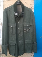 Original German SS officers M35 jacket,insignia is copy as are the medals,nice condition,large size and very rare to find came from large collection in Koblenz 20 years ago