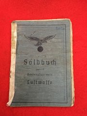 Luftwaffe soldiers soldbuch complete with photograph for truck driver at night fighter base with many markings and stamps dated 1939-1945 he lived in Aachen