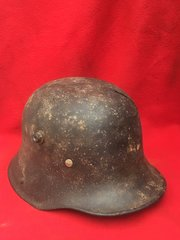 German soldiers M16 helmet very nice condition leather liner,black paintwork very smooth finnish,restoration project recovered from The 1916 Somme battlefield