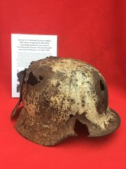 Rare German SS Totenkopf Division soldiers M40 helmet single decal with white camouflage paintwork and battle damage recovered in the Demyansk Pocket in Russia 1942 battlefield