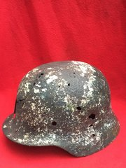 German Soldiers M35 pattern Helmet with direct hit blast damage impact hole in the front recovered from around the town of Bray Dunes which was in the centre of the Dunkirk Pocket in 1940