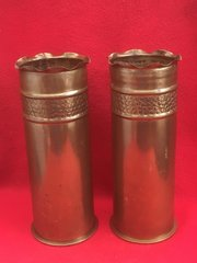 German 77mm shell cases matching pair of Trench art stripe and pebble dash design the cases are dated 1916,1917 found on the Somme battlefield 1916-1918