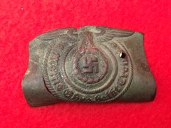 German SS soldiers belt buckle recovered from Death Valley near Hill 112 the battle in the Falaise Pocket on the Normandy battlefield of 1944