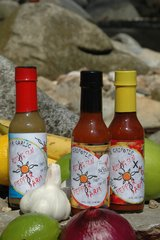 """The Triple"" (3 - 5oz bottles) one each of Three Pepper Garlic and the Apple Cinnamon Chipotles ( medium & X-Hot )"