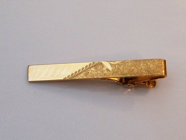 Signed Vintage Tie Clip. Textured Top In Gold Tone.