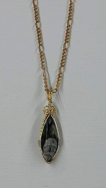 Fossil precious stone with gold and silver plating
