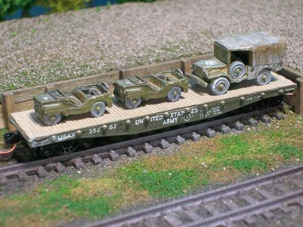 (2) Jeeps and 3/4 Ton Cargo Truck on US Army Transportation Corp Flat Car