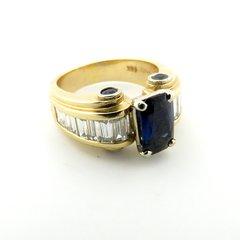Contemporary sapphire and diamond ring 14k