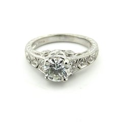 Platinum and diamond engraved ring