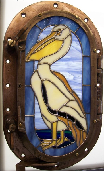 Pelican in porthole