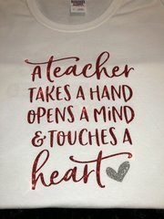 A Teacher takes a Hand....