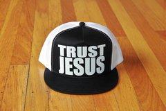 TRUST JESUS SNAP BACK TRUCKER HAT WHITE/BLACK BILL/WHITE LOGO
