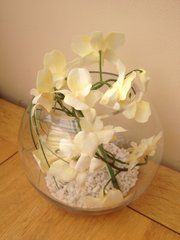CREAM DENDROBIUM ORCHID & BEAR GRASS IN GLASS BOWL WITH GRAVEL AND WATER