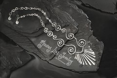 Cosmic Spiral Necklace with Silver-Feathered Pendant