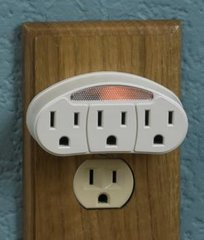 Three grounded outlets with sensor night light