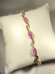 10k pink ice stone bracelet. B101