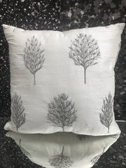 beautiful silk cream scatter cushions with tree and bead detail