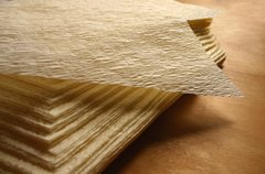 a 5 1/2 x 8 inch textured tamale parchment wrap (corn husk substitute); small: rectangle 5 1/2 x 8 inch, corn-yellow, case of 1,000