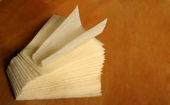 a textured tamale parchment wrap (corn husk substitute); a triangular 9-inch sheet, corn-yellow, case of 1,000
