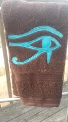 Brown Left Eye of Heru Hand Towel with Baby Blue Batik