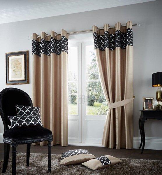 Shiny gold eyelet curtains