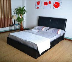 Austin black faux leather bed frame
