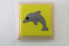 Dolphin on yellow