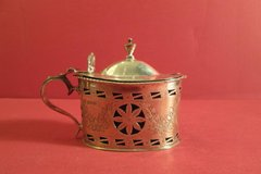 Sterling silver mustard pot with rusticated sides, oval shape, gadrooning around the top. Original blue liner. Chester, 1902.