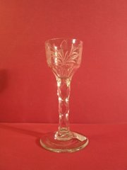 English wine glass with faceted stem and floral engraved bowl, ca. 1750-1760.