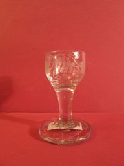 Anglo-Irish dram glass, 18th century, with grape cluster etched bowl on round foot.