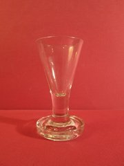 Drinking Glasses. English 18th century firing glass on round base.