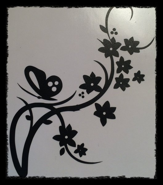 vinyl wall art butterfly on flowered vine comes in various sizes and colours