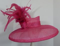 Big Brimmed Hot Pink Kentucky Derby hat with Feathers, netting and 2 hand tooled silk flowers