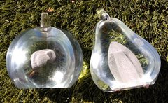 Exbor Glass Works Apple and Pear cut away sculptures.