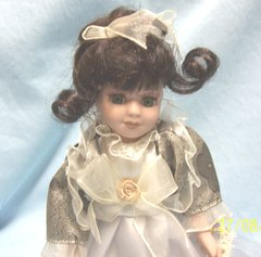 """DOLLS: Collectible Doll 8 1/2"""" Porcelain Doll with Black Hair Gorgeous Green Eyes"""