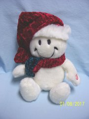 "ANIMATED MUSICAL SNOWMAN: Whimsical 11.5"" tall snowman Hops & Sings to Jingle Bells Battery Operated"