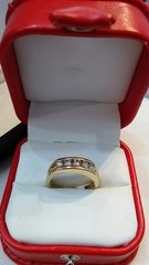Men 14 K solid yellow ban ring with real diamonds 1.8 CWT.