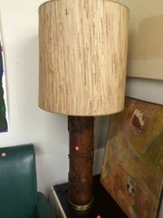 Carved wood table lamp w cool barrel shade.